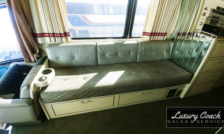 View of the Bench Seating of 1985 MCI 96-A3 at Luxury Coach