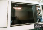 View of the Microwave of 1985 MCI 96-A3 at Luxury Coach