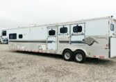View of the Driver Side of a 99 Sundowner Horse Trailer at Luxury Coach