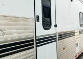 View of the Secondary Entry in a 1999 Sundowner Horse Trailer at Luxury Coach