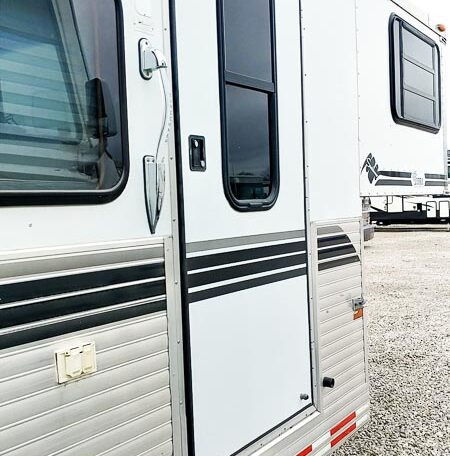 View of the Exterior Door in a 1999 Sundowner Horse Trailer at Luxury Coach