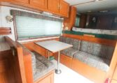 View of the Dining Area in a 1999 Sundowner Horse Trailer at Luxury Coach