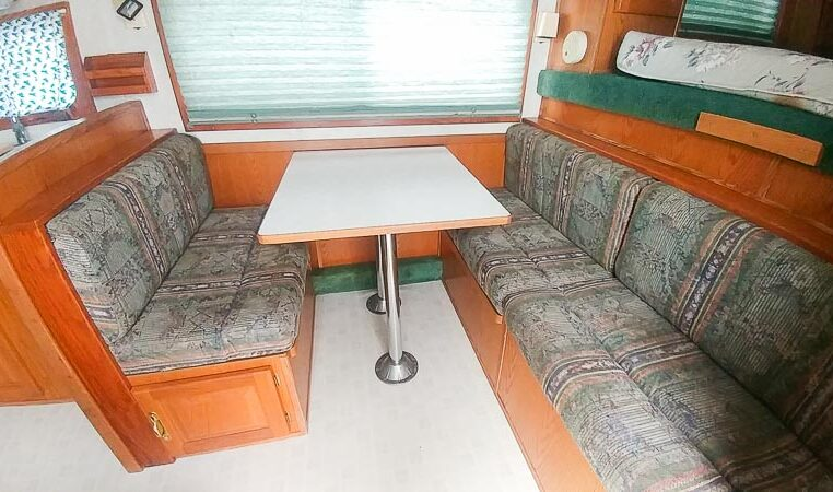 View of the Dinette in a 1999 Sundowner Horse Trailer at Luxury Coach