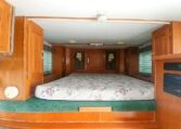 View of the Sleeping Area in a 1999 Sundowner Horse Trailer at Luxury Coach