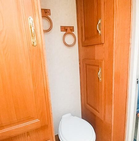 View of the Toilet in a 1999 Sundowner Horse Trailer at Luxury Coach