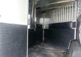 View of the in head stall in a 1999 Sundowner Horse Trailer at Luxury Coach