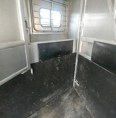 View of the Horse Stalls in a 1999 Sundowner Horse Trailer at Luxury Coach