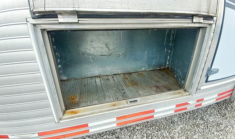 View of the Underbay Storage in a 1999 Sundowner Horse Trailer at Luxury Coach